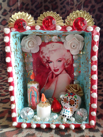 Marilyn roams the netherworld snacking on paste diamonds, flameless candles, plastic flowers, and bedazzled skulls.