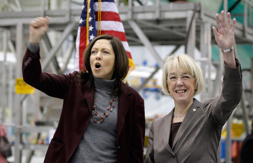 WA senators Cantwell (left) and Murray (right) enjoined in corporate cheer at a rally at Boeing in Seattle
