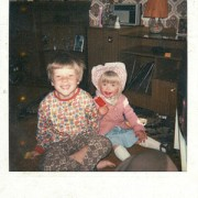 A Polaroid of a young Damian with his sister.