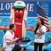 Joey Chestnut drops to his knees before Neslie Ricasa this July