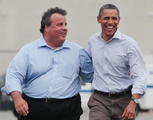 President Barack Obama walks with New Jersey Gov. Chris Christie in Newark, N.J., as they returned from Paterson, N.J., after viewing damage caused by Hurricane Irene, Sunday, Sept. 4, 2011. (AP Photo/Charles Dharapak)