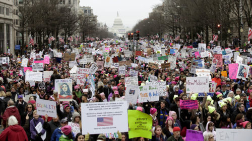 Demonstrators protest during the Women's March along Pennsylvania Avenue January 21, 2017 in Washington, DC. Hundreds of thousands of protesters spearheaded by women's rights groups demonstrated across the US to send a defiant message to US President Donald Trump. / AFP / Joshua LOTT (Photo credit should read JOSHUA LOTT/AFP/Getty Images)